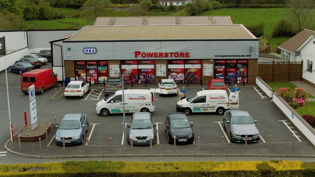 HBA Powerstore building in Keady with company vans and customer cars.